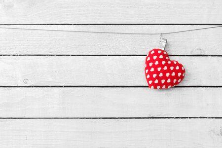 Heart Fabric hang over white wood background Zdjęcie Seryjne