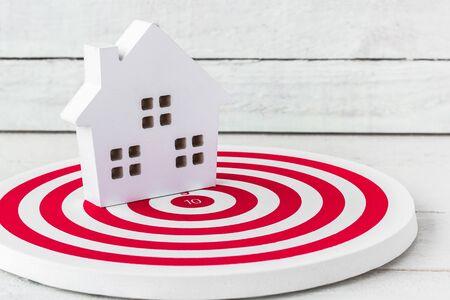 Wood Home Shaped on dartboard. Select Home Conccept. Standard-Bild