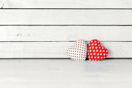 Fabric Heart over white wood background