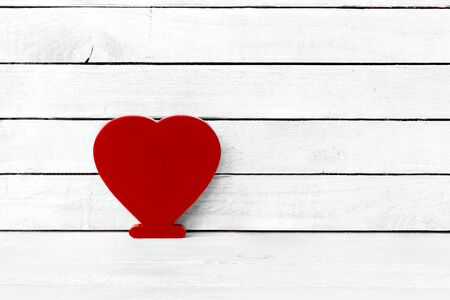 Red Heart Shaped over white wood background