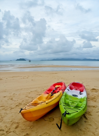 The two kayak on the cloudy beach photo