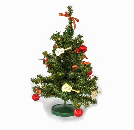 The model of christmas tree that decorate by golden guitar, red bow and ball Stock Photo - 18836961