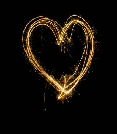 The idea picture of heart image that make of fireworks on black screen photo