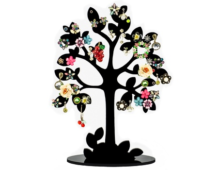 The black tree is decorated with various earring photo