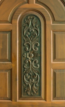 teakwood: The picture of design sculpture on teakwood that popular in Thai style house Stock Photo