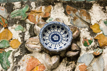 invents: old china antique with blue patterns , taking porcelain come to invent is a flower and decorate at the pagoda , Wat Aroon Bangkok Thailand  Stock Photo