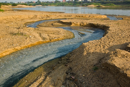 fluffy tuft: middle stream is Chow Phya River , in the winter , the water in the Chow Phya River has a little , it make to see sandy and soil location middle river,Photo on December 28, 2012 in Sing Buri Province Thailand Stock Photo