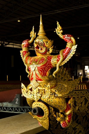 invents: Thai arts , the work decorates the head portion of His Majestys ancient Ship , call that warship GARUDA HERN HEJ TREJ TRAI JAK (Garuda veer over the three world) at royal yacht museum Bangkok Thailand, Photo on February 12,2013 Editorial