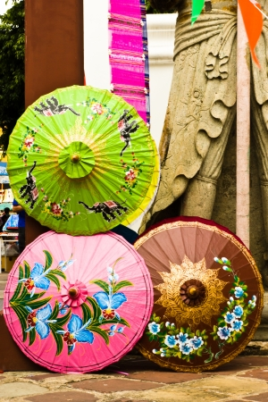 invents: BANGKOK APRIL 15: The decorate whitw 3 umbrella at Wat Pho on April 15, 2013 in Bangkok. Stock Photo