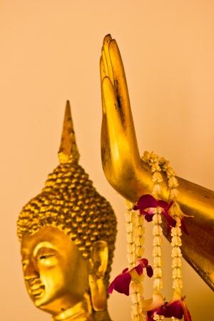 BANGKOK APRIL 15: Hand of Buddha on yellow background at Wat Pho on April 15, 2013 in Bangkok. Zdjęcie Seryjne