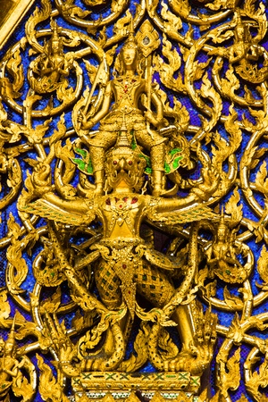 invents: BANGKOK APRIL 17: Work stucco arts decorates with mosaic at Wat Phra kaew on April 17, 2013 in Bangkok. Editorial