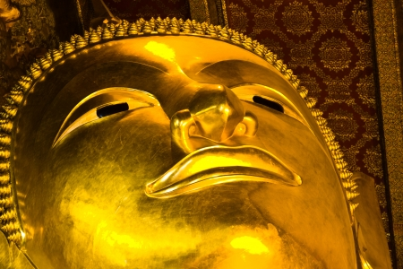 BANGKOK APRIL 18: Face of Buddha in the temple at Wat Pho on April 18, 2013 in Bangkok. Zdjęcie Seryjne