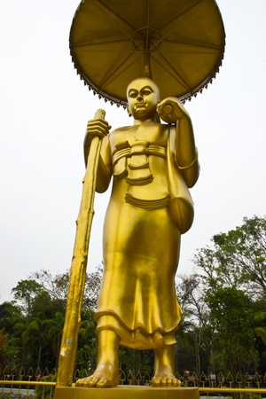invents: THAILAND APIRL 6  Golden Buddha walk posture at Wat Pikulthong on Apirl 6,2013 in Singburi Province Thailand
