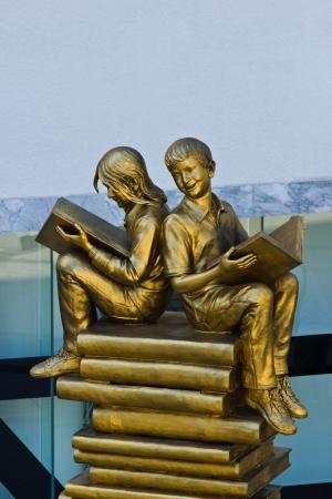 BANGKOK MAY 8  Golden boy and girl statue at Wold book Capital 2013 on May 8,2013 in Bangkok  Publikacyjne