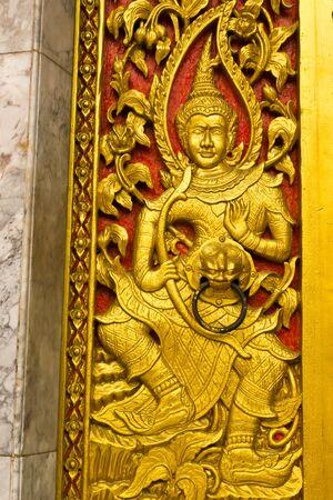 BANGKOK MAY 11  Thai arts sculpture on door panel at Laksi temple on May 11,2013 in Bangkok