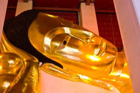 THAILAND SEPTEMBER 1 Face of golden Buddha lie down posture under construction at Wat Phra Norn Jaksi on September 1, 2013 in Singburi Province Thailand