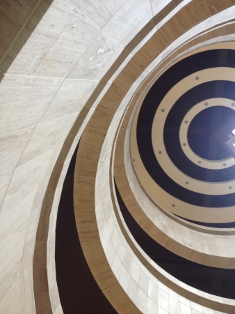 Low view of a building stairs and ceiling