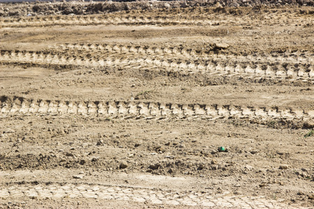 tillage: plowed land in the agricultural field after harvest of cereal, tractor tracks on the ground Stock Photo