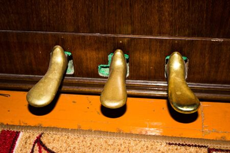pedals: Close up of brass piano pedals