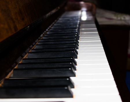 warm color: Piano keyboard background with selective focus. Warm color toned image