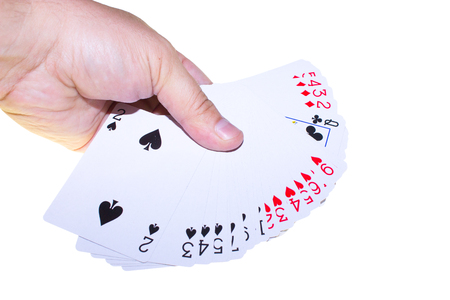 a deck of cards in hand on a white background