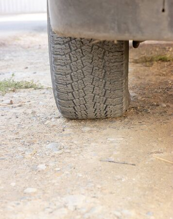 black rear wheels of a car standing on the ground