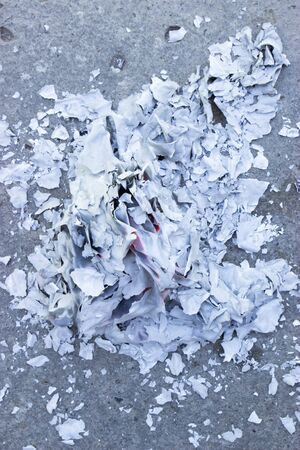 burning paper on the ground, polluted ecology