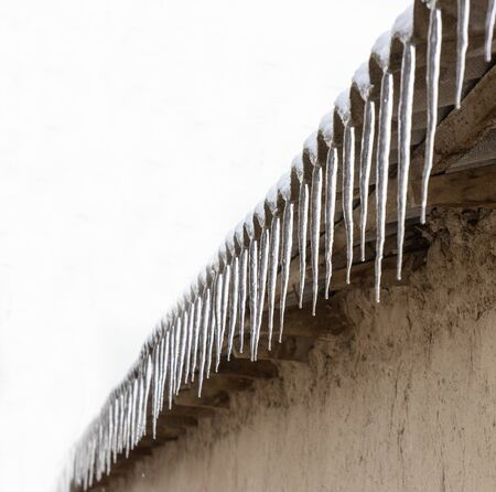 icicles under the roof of the house Foto de archivo