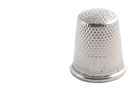 Isolated closeup of thimble on a white blackground photo