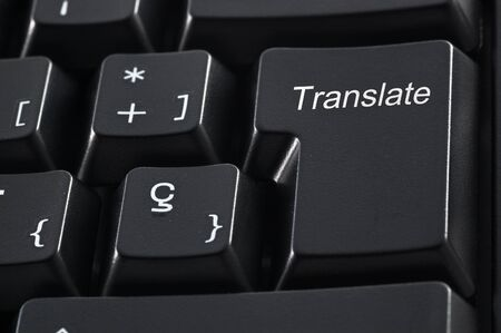 enter key: Computer keyboard with the word translate instead of the Enter key Stock Photo