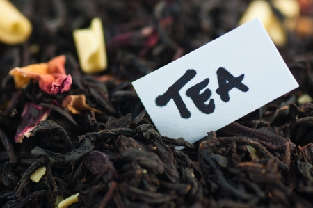 Close-up of tea blend with the words tea in a note photo