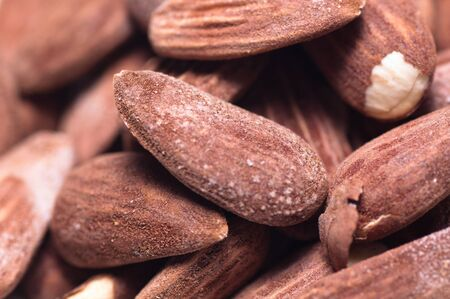 Closeup of several salted and toasted almonds photo
