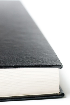 hard cover: Closed book with a black  hard cover on a white background