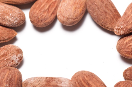 cholesterol free: Group of almonds on a white background with copyspace in the middle