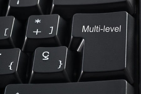 Black keyboard with the words multi-level marketing photo