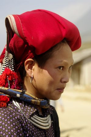 Hmong woman red pompoms