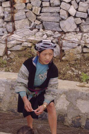 Portrait of a young blue Hmong woman  photo