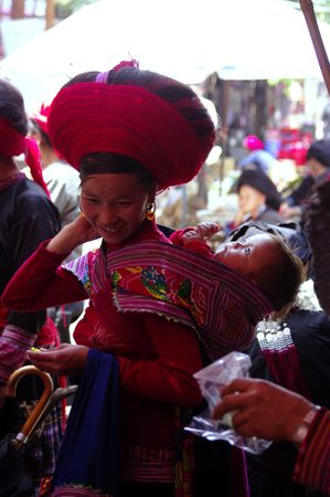 Woman red Hmong with her baby Stock Photo - 7872774