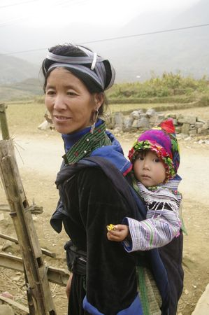 Portrait of a young blue Hmong woman and baby