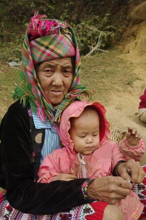 ethnic customs: Grandma  flowered Hmong and her little girl Stock Photo