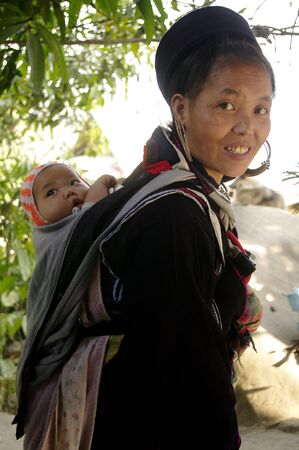 Black Hmong ethnic woman and baby photo