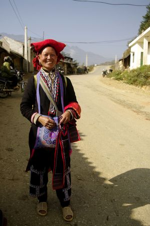 Ethnic Hmong woman red pompoms  photo