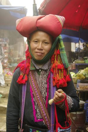 Hmong red pompons woman photo