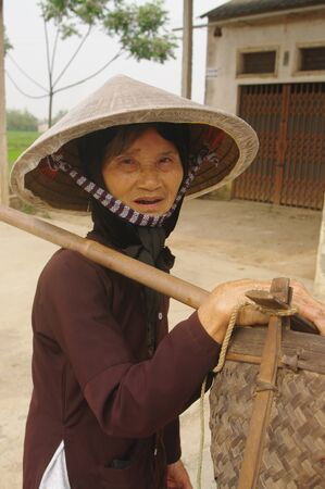 portrait of an old peasant kinh (viet) photo