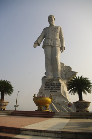 Statue of Ho Chi Minh in Hoa Binh  Enormous monument to Uncle Ho s  The statue was mounted on the mountain overlooking the Hoa Binh dam northwest of Hanoi  A vase is placed in front of the statue for the pilgrims settle the incense stick