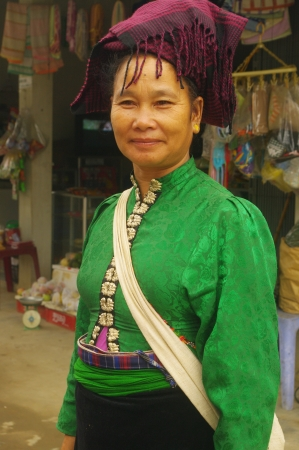 Portrait of a Thai woman white  The difference with the Thais and the rotator black women who can be of different colors in the White Thai  s blouse buttoned at the front and the rest straight black skirt suit traditional common