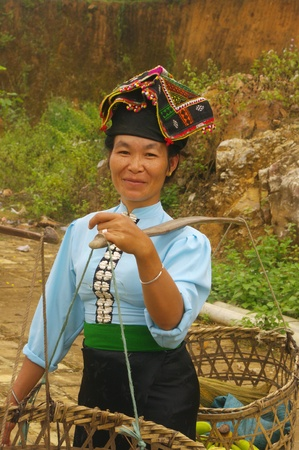 The Khang ethnic woman in her traditional costume back from Sunday market where shesold her vegetables  Stock Photo