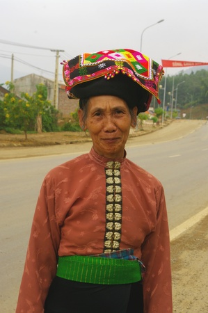 This beautiful grandmother is an ethnic Thai black  It has the traditional costume of his tribe  This woman is of great elegance to go to the Saturday market  Blouse buttoned right color on the front  A green belt fabrics now a scholarship in plaids  The  Stock Photo