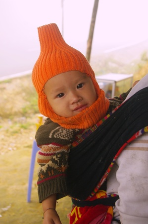 Thai baby in back his mother