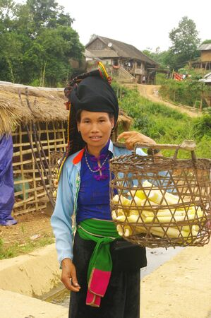 The Thai woman is wearing her traditional dress